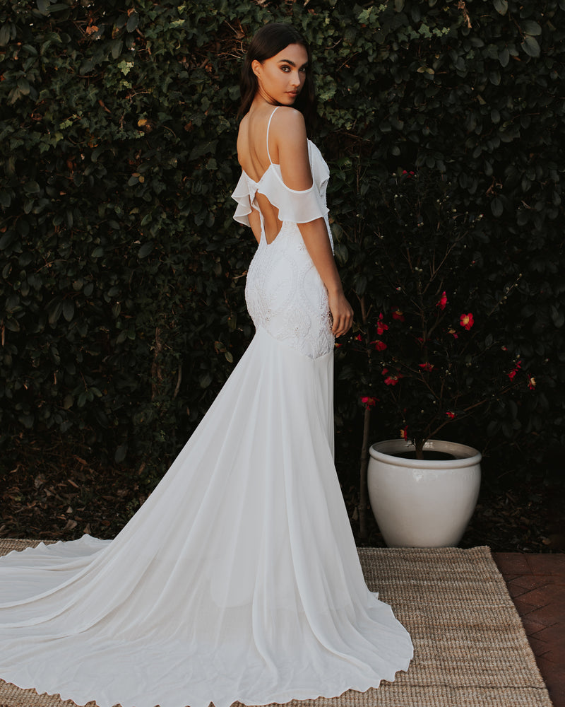 Model wearing beaded Tulum bridal gown in Ivory/Ivory by Katie May