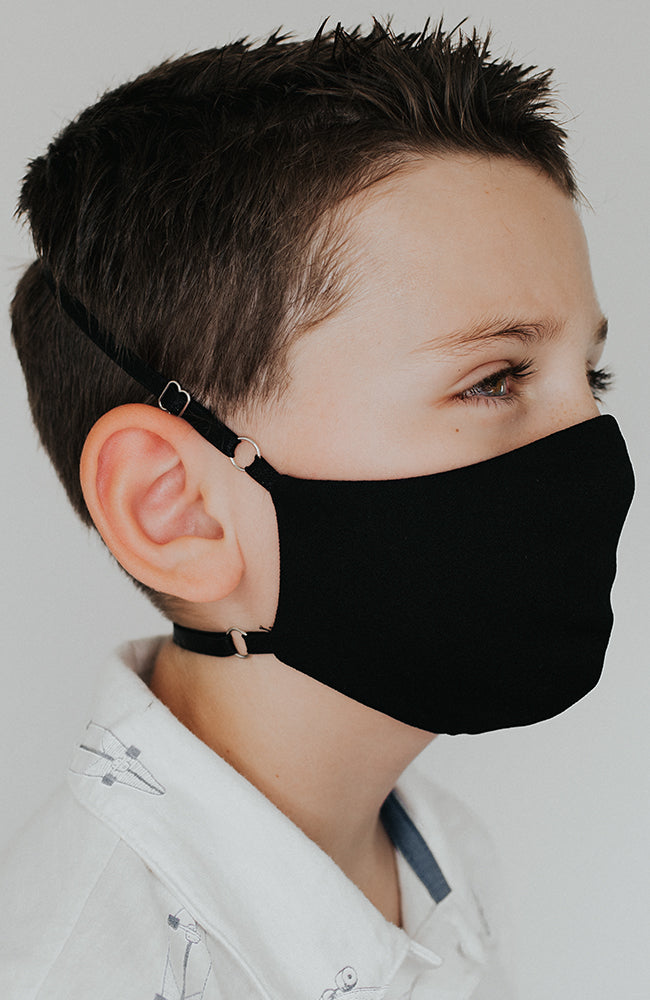 Model is wearing Protected Mini mask in Black by Katie May