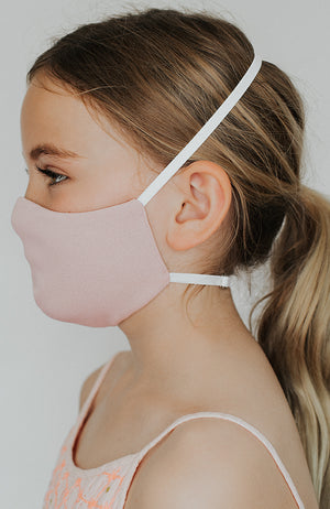 Model is wearing Protected Mini mask in Blush by Katie May