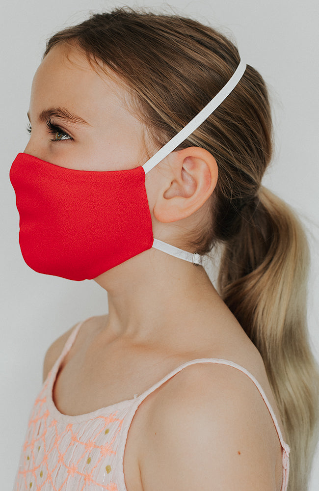 Model is wearing Protected Mini mask in Cherry by Katie May