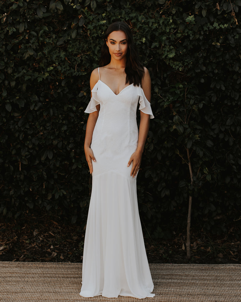 Model wearing lace Tulum bridal gown in Ivory/Ivory by Katie May