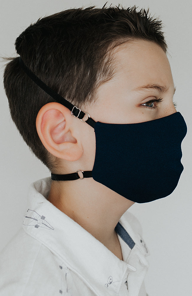 Model is wearing Protected Mini mask in Navy by Katie May