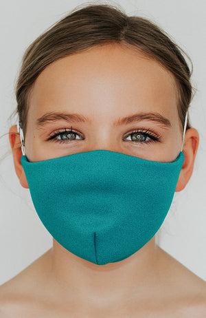 Model is wearing Protected Mini mask in Seagreen by Katie May