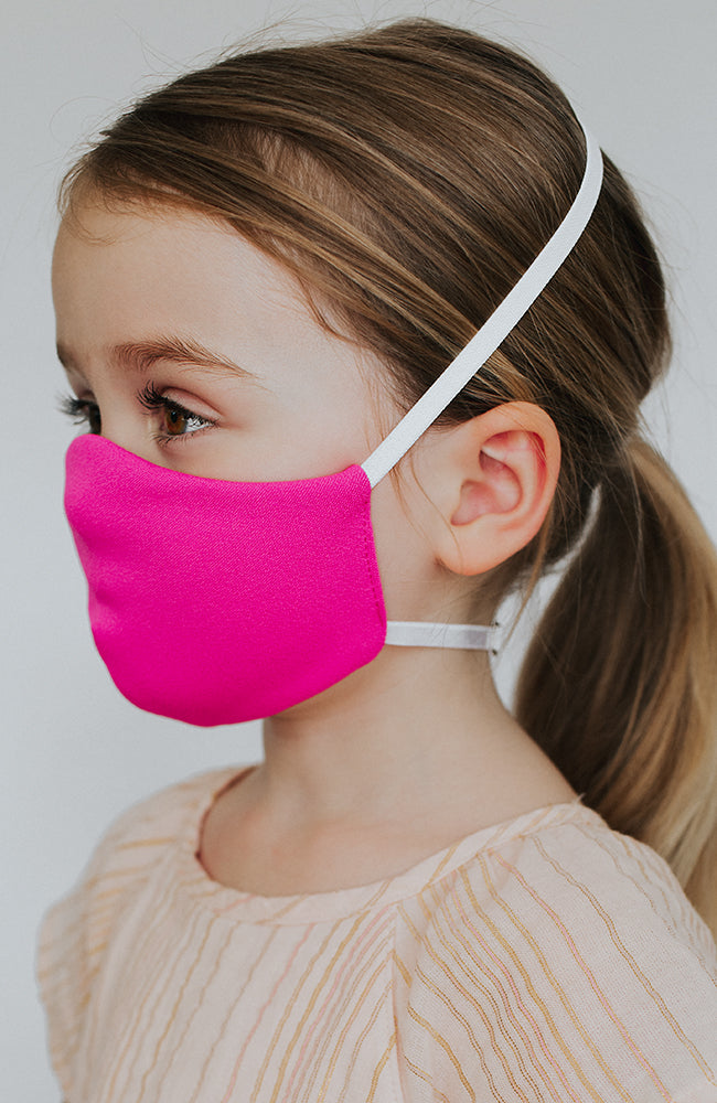 Model is wearing Protected Mini mask in Electric Pink by Katie May
