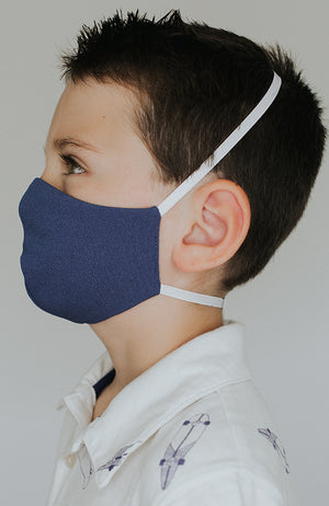 Model is wearing Protected Mini mask in Steel Blue by Katie May