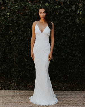 Model wearing Cannes bridal gown in Ivory/Ivory by Katie May