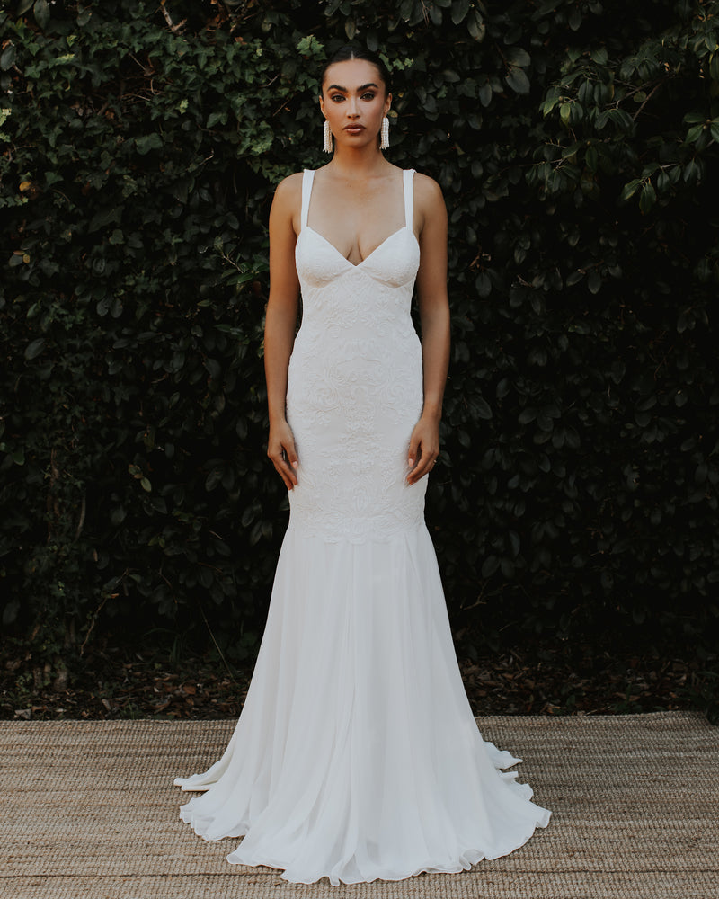 Model wearing Monaco bridal gown in Ivory/Ivory by Katie May