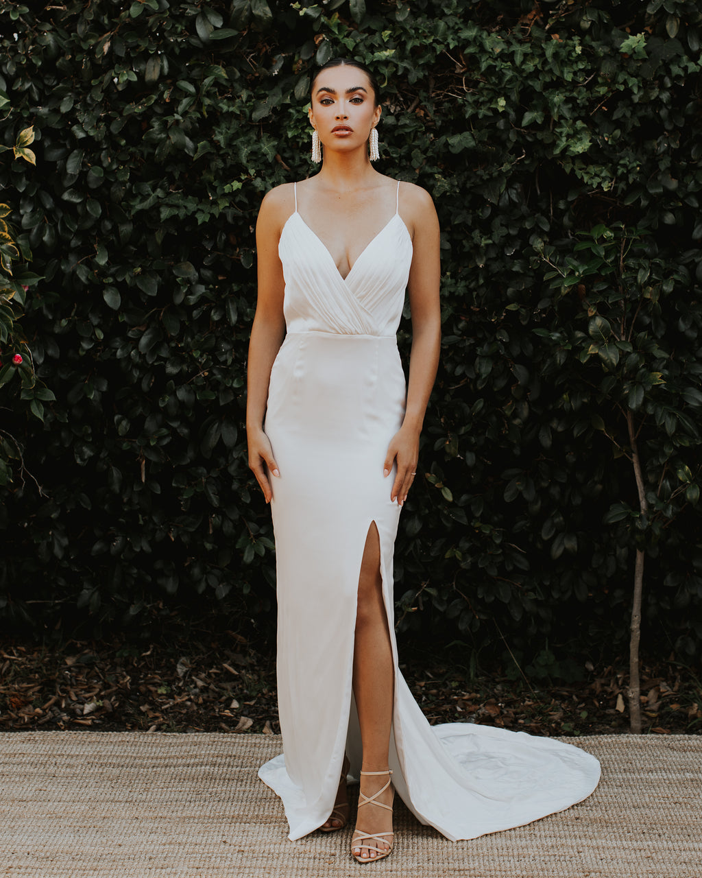 Model wearing Avalon bridal gown in Ivory by Katie May