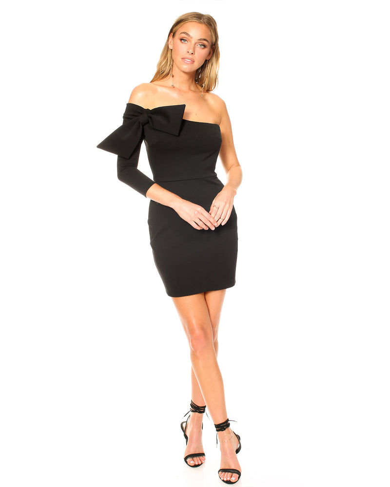 Model wearing black special occasion Katie May dress