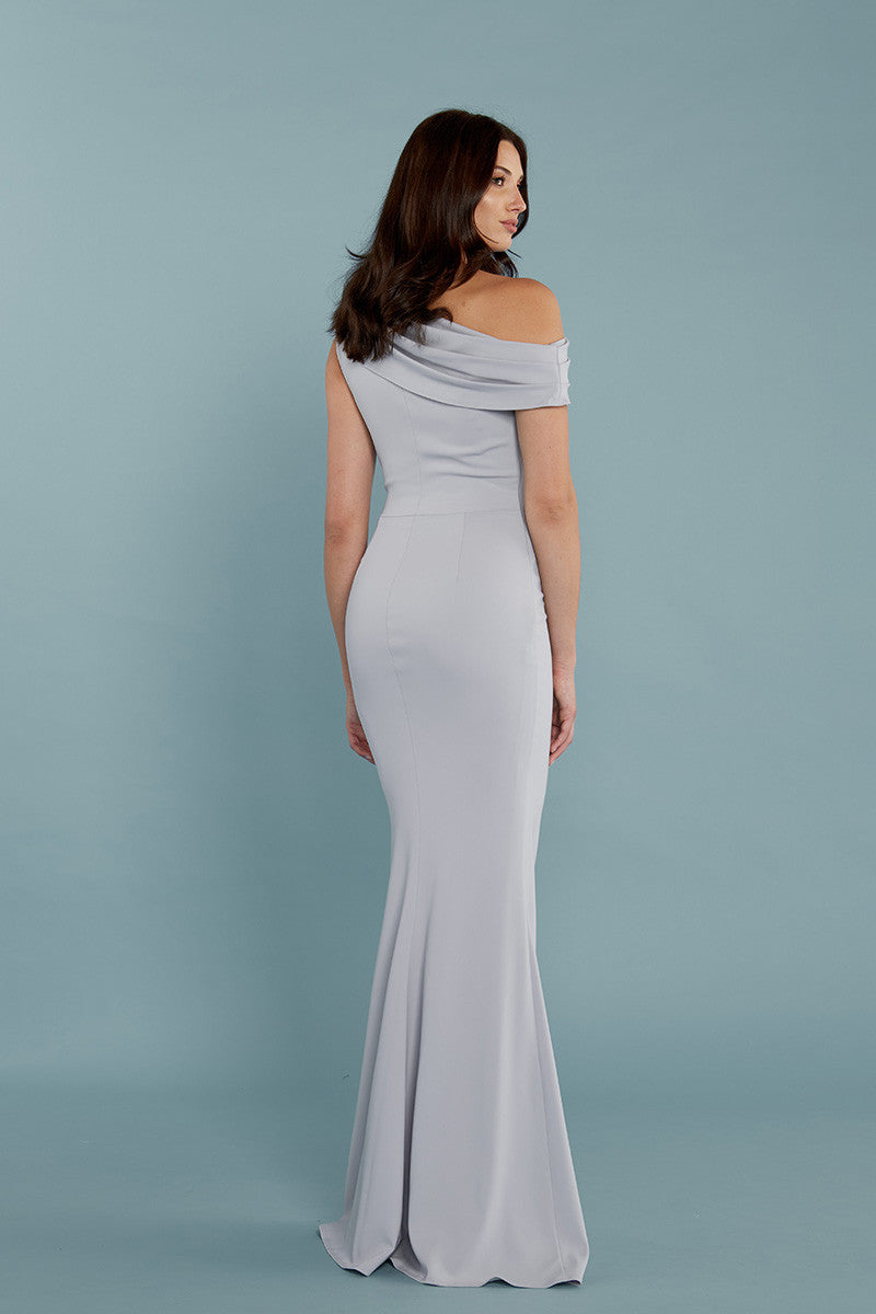 Model is wearing Layla dress in Dove by Katie May