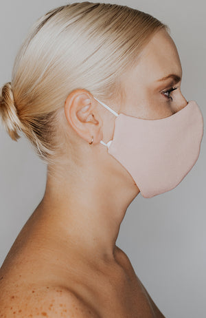 Model wearing practiCALI mask in Blush by Katie May