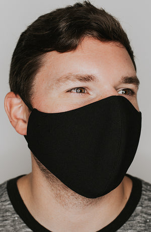 Model wearing practiCALI mask in Black by Katie May