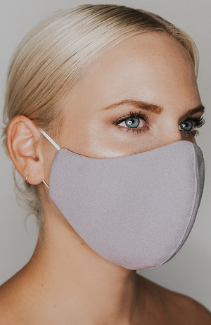 Model wearing practiCALI mask in Dove by Katie May