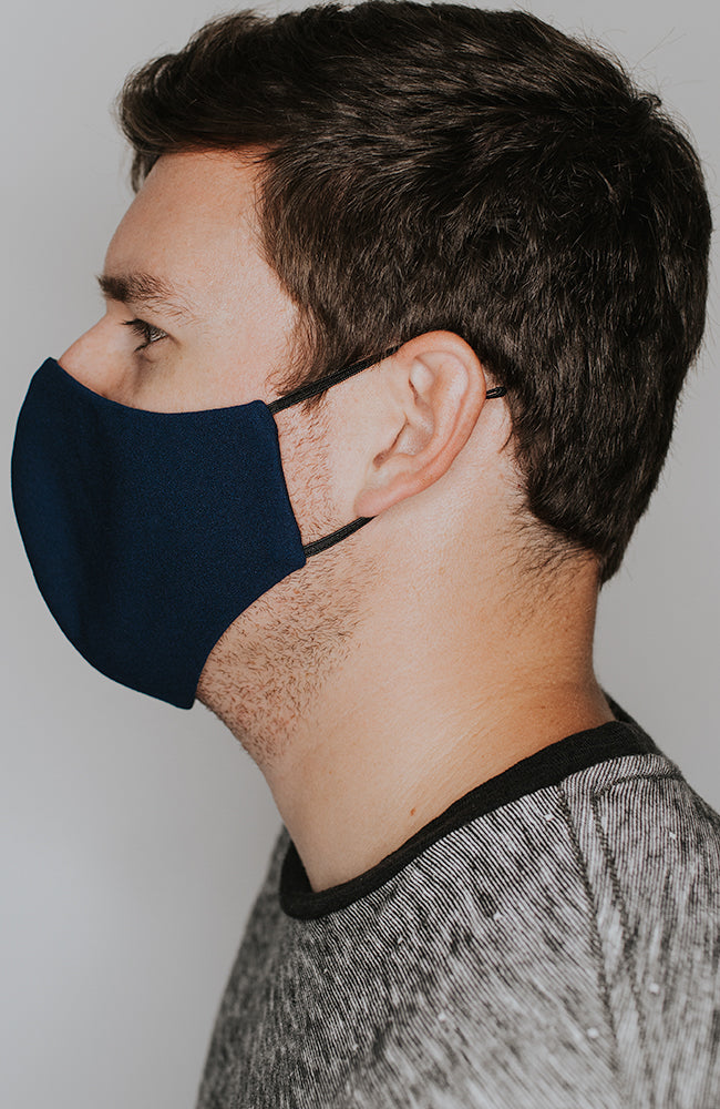 Model wearing practiCALI mask in Navy by Katie May
