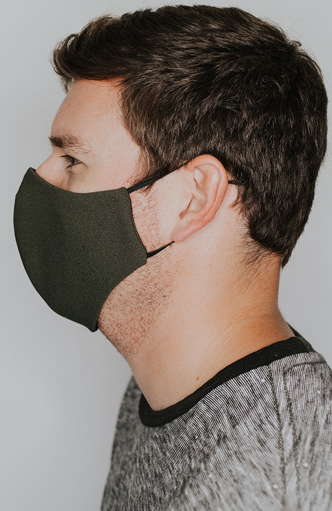 Model wearing practiCALI mask in Olive by Katie May