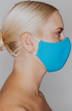 Model wearing practiCALI mask in Turquoise by Katie May