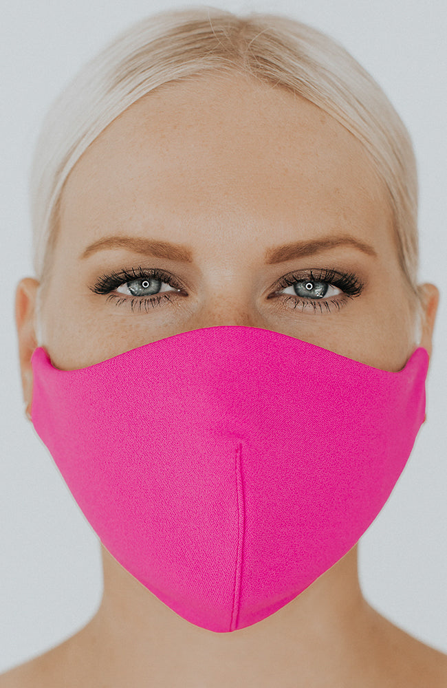 Model wearing Protected AF with Ear Loops in Electric Pink by Katie May
