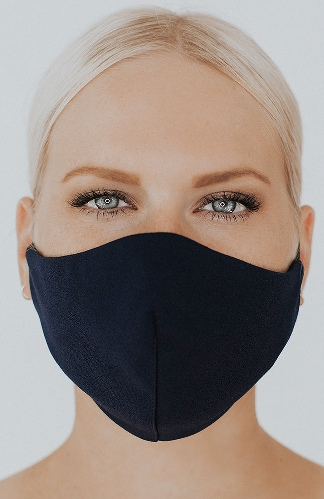 Model wearing Protected AF with Ear Loops in Navy by Katie May