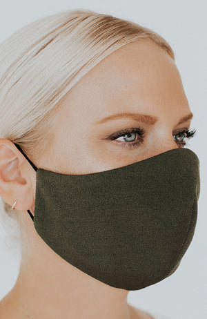 Model wearing Protected AF with Ear Loops in Olive by Katie May