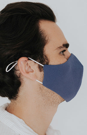 Model wearing Protected AF with Ear Loops in Steel Blue by Katie May
