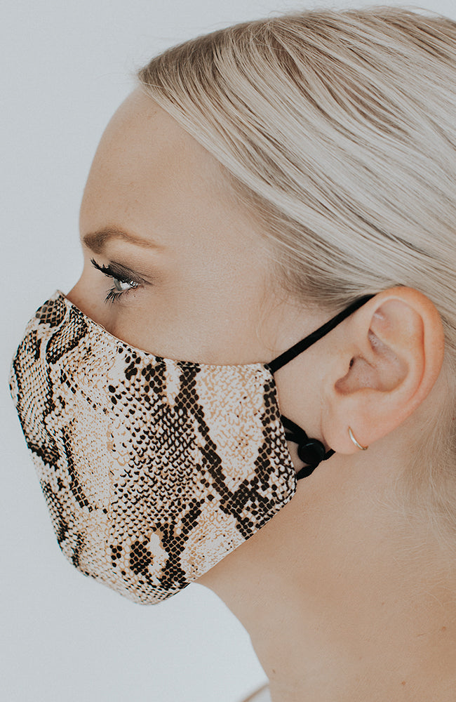 Model wearing Slitherina mask in Neutral Snake by Katie May