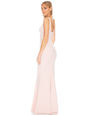 Model wearing Westward gown in Blush by Katie May