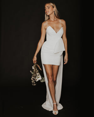 Model wearing Eden Rock dress in Ivory by Katie May