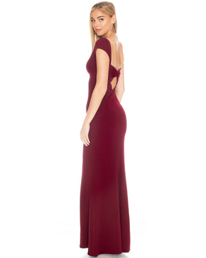 Model wearing Madison gown in Bordeaux by Katie May