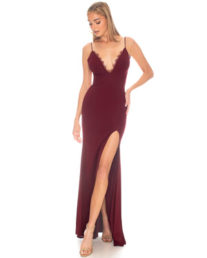 Model wearing Saylor gown in Bordeaux by Katie May