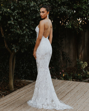 Model wearing The Lady bridal gown in Ivory/Nude by Noel & Jean by Katie May