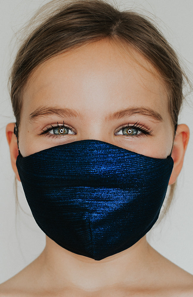 Model wearing Glow Up Mini mask in Blue Metallic by Katie May