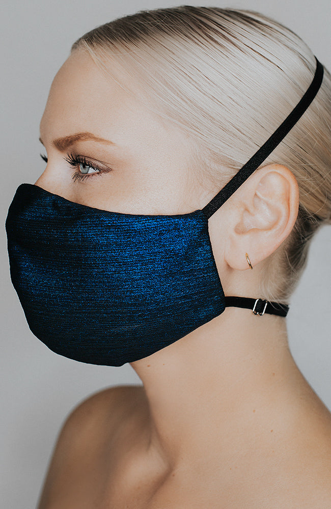 Model is wearing Glow Up mask in Blue Metallic by Katie May