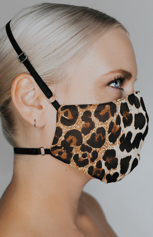 Model is wearing Kitty May mask in Leopard by Katie May