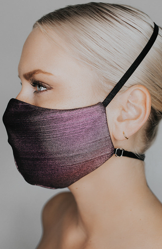 Model is wearing Glow Up mask in Plum Metallic by Katie May