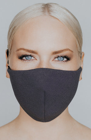 Model wearing Protected AF mask in Charcoal by Katie May