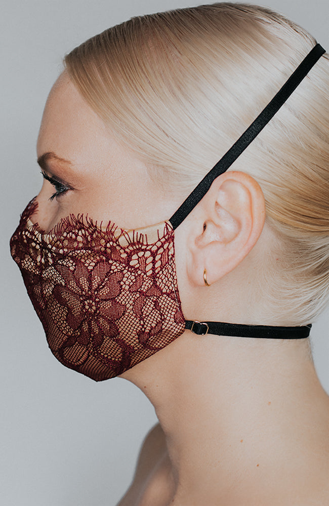Model is wearing Provocateur mask in Bordeaux/Nude by Katie May