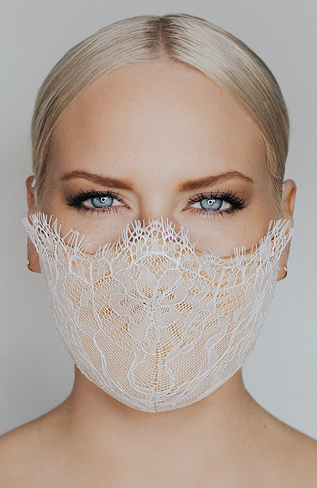 Model wearing Provocatuer coronavirus face mask in ivory with lace by Katie May