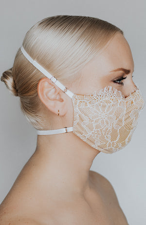 Model is wearing Provocateur mask in Ivory/Nude by Katie May