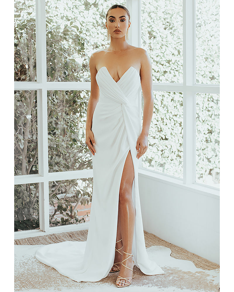 Model wearing Wisteria bridal gown in Ivory by Noel & Jean by Katie May