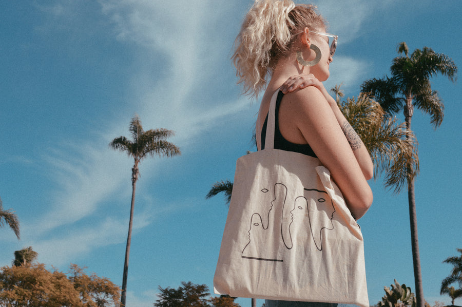 Line of Faces Tote Bag