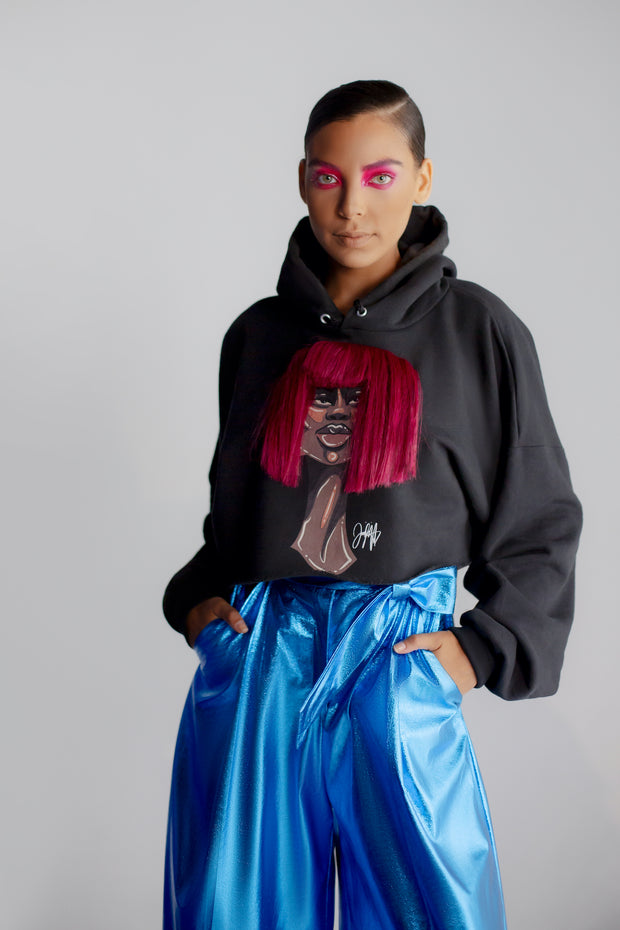 Model wearing black hoodie featuring 3D version of Zuri bob artwork by Taylor Ramsie