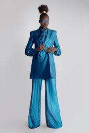 Model wearing teal lace wide leg trousers