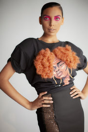 Model wearing black t-shirt featuring 3D version of Naomi afro puff artwork by Taylor Ramsie