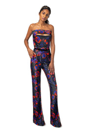 Front of model wearing red floral Lynn bootcut pants