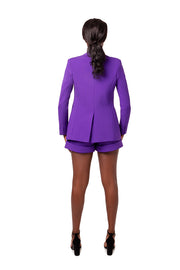 Back of model wearing purple Ayva boyfriend style blazer