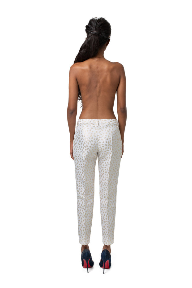 Back of model wearing white relaxed fit cropped pants