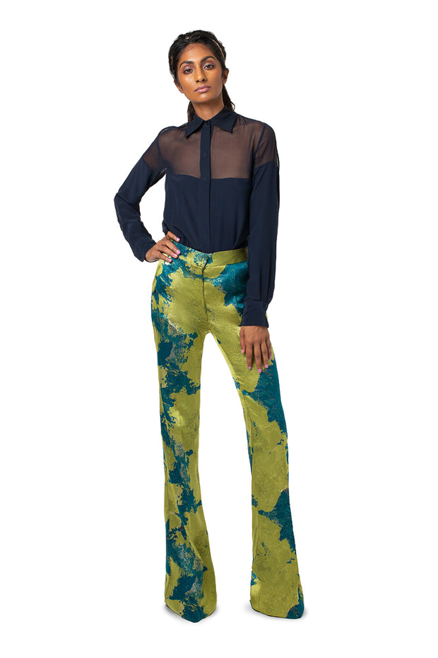 Front of model wearing teal print Lynn boot cut pants