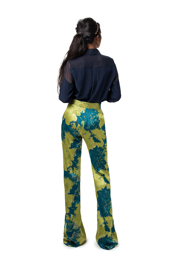 Back of model wearing teal print Lynn boot cut pants