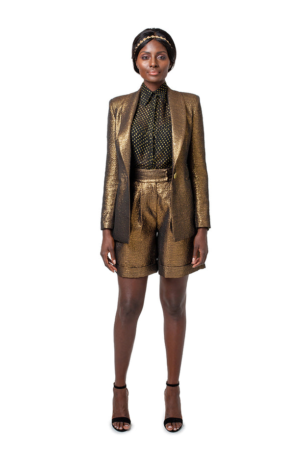 Front of model wearing bronze Ayvs boyfriend style blazer