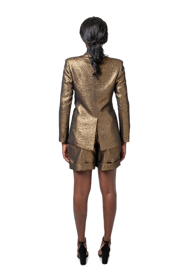 Back of model wearing bronze Ayvs boyfriend style blazer